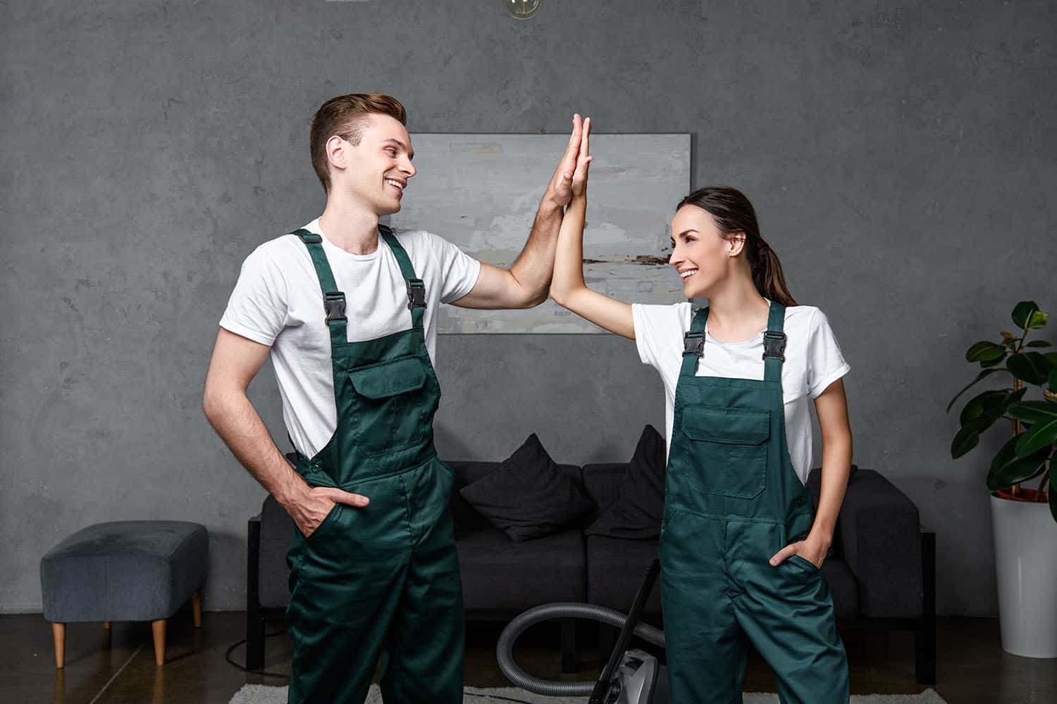Happy young professional cleaning company workers