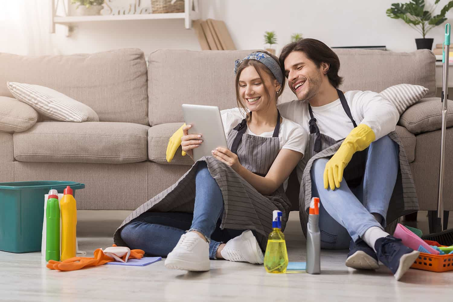 Smiling couple relaxing among cleansing tools